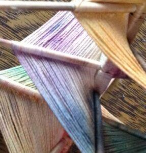 God's Eye variation with handpainted threads. SlowYarn.com