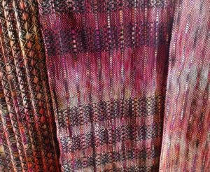 Weavings with handdyed warp