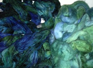 Cotton rayon warp threads and Wool roving being rinsed in the sink.