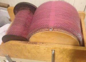 rose pink wool on drum carder