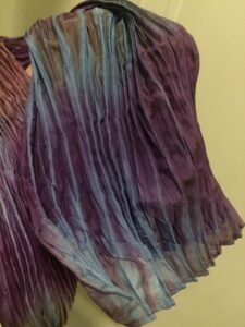 pleats of a shibori dyed silk scarf at slowyarn.com