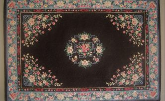petit point miniature Oriental carpet worked on silk gauze