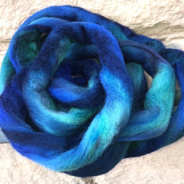dried dyed wool roving showing bright color changes